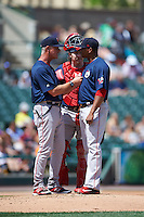 Pawtucket Red Sox pitching coach Bob Kipper (13) talks with starting pitcher Roenis Elias (29) as catcher Ryan Hanigan (35) listens in during a game against the Rochester Red Wings on June 29, 2016 at Frontier Field in Rochester, New York.  Pawtucket defeated Rochester 3-2.  (Mike Janes/Four Seam Images)