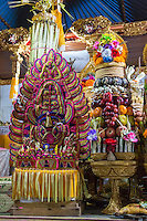 Bali, Indonesia.  Temple Offerings of Fruit, Eggs, and Sweets in Hope of a Good Rice Harvest, Pura Dalem Hindu Temple, Dlod Blungbang Village.  The offering on the left is a representation of the rice goddess Sri.