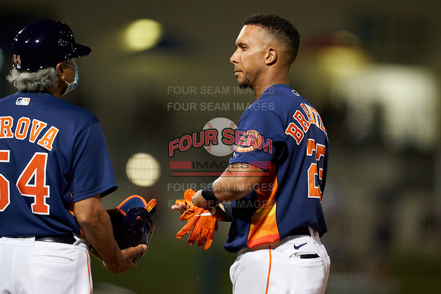 Houston Astros Michael Brantley (23) talks with first base coach Dan Firova (54) during a Major League Spring Training game against the Washington Nationals on March 19, 2021 at The Ballpark of the Palm Beaches in Palm Beach, Florida.  (Mike Janes/Four Seam Images)