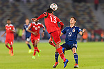 Khalid Al Braiki of Oman (L) fights for the ball with Muto Yoshinori of Japan (R) during the AFC Asian Cup UAE 2019 Group F match between Oman (OMA) and Japan (JPN) at Zayed Sports City Stadium on 13 January 2019 in Abu Dhabi, United Arab Emirates. Photo by Marcio Rodrigo Machado / Power Sport Images