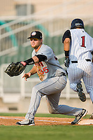 Hagerstown first baseman Robby Jacobsen (35) waits for a throw as Kannapolis shortstop Sergio Miranda (1) beats out an infield single at Fieldcrest Cannon Stadium in Kannapolis, NC, Sunday, August 12, 2007.