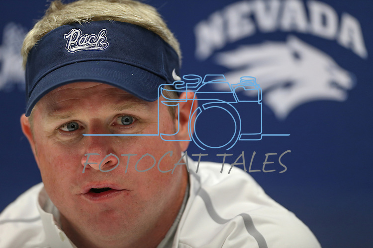 Nevada Head Coach Brian Polian answers media questions following an NCAA college football game against Arizona in Reno, Nev., on Saturday, Sept. 12, 2015. (AP Photo/Cathleen Allison)