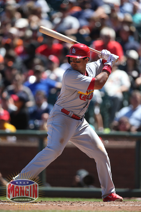 SAN FRANCISCO, CA - JULY 3:  Jon Jay #19 of the St. Louis Cardinals bats against the San Francisco Giants during the game at AT&T Park on Thursday, July 3, 2014 in San Francisco, California. Photo by Brad Mangin