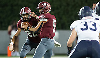 Landon Phipps (5) of Springdale hands the ball off to Gilberto Dominguez (22) against Springdale Har-ber at Jarrell Williams Bulldog Stadium, Springdale, Arkansas on Friday, October 9, 2020 / Special to NWA Democrat-Gazette/ David Beach