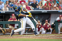 Michigan Wolverines designated hitter Jordan Nwogu (42) swings the bat during Game 6 of the NCAA College World Series against the Florida State Seminoles on June 17, 2019 at TD Ameritrade Park in Omaha, Nebraska. Michigan defeated Florida State 2-0. (Andrew Woolley/Four Seam Images)