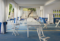 What was once a restaurant has become a wonderful open-plan dining space open to the sea and its cooling breezes