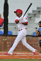 Johnson City Cardinals shortstop Kenny Peoples-Walls #12 swings at a pitch during a game against the Bristol White Sox at Howard Johnson Field on August 19, 2013 in Johnson City, Tennessee. The White Sox won the game 5-4. (Tony Farlow/Four Seam Images)