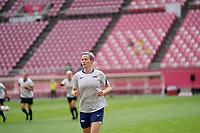 KASHIMA, JAPAN - JULY 27: Megan Rapinoe #15 of the United States warming up before a game between Australia and USWNT at Ibaraki Kashima Stadium on July 27, 2021 in Kashima, Japan.