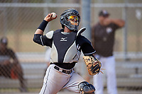 Miami Marlins catcher Pablo Garcia (5) throws to first base during a minor league Spring Training game against the New York Mets on March 26, 2017 at the Roger Dean Stadium Complex in Jupiter, Florida.  (Mike Janes/Four Seam Images)
