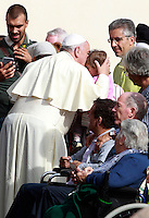 Papa Francesco saluta una bambina al termine dell'udienza generale del mercoledi' in Piazza San Pietro, Citta' del Vaticano, 15 ottobre 2014.<br /> Pope Francis greets a child at the end of his weekly general audience in St. Peter's Square at the Vatican, 15 October 2014.<br /> UPDATE IMAGES PRESS/Isabella Bonotto<br /> <br /> STRICTLY ONLY FOR EDITORIAL USE