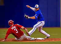 26 March 2018: Toronto Blue Jays shortstop Aledmys Diaz is unable to get a sliding Jedd Gyorko out at second during an exhibition game against the St. Louis Cardinals at Olympic Stadium in Montreal, Quebec, Canada. The Cardinals defeated the Blue Jays 5-3 in the first of two MLB pre-season games in the former home of the Montreal Expos. Mandatory Credit: Ed Wolfstein Photo *** RAW (NEF) Image File Available ***