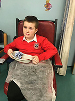 "Pictured: Troy Wheaton receiving treatment for his cut tongue.<br /> Re: Schoolboy Troy Wheaton, 11, was left needing nine stitches in his tongue following an altercation at Idris Davies School in Abertysswg in the Rhymney Valley, south Wales, but he hasn't been back since January 14 after he was left ""bleeding and crying.""<br /> His father Matthew Wheaton, 34, is angry because he says no one from the school let them know what had happened.<br /> Mr Wheaton was shopping with his wife Kathryn, 33, where on their way back from shopping when they received a phone call from Kathryn's mother.<br /> Mr Wheaton said: ""Kathryn's niece was in school and said something had happened with Troy and his mouth was bleeding. We had been hearing things through the family.<br /> ""We were going to ring the school when our older daughter said he had been in some sort of fight and his mouth was bleeding. Not a single person or member of staff from the school rang us."" he added."