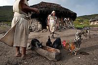 Arhuaco woman is feeding the animals. Sierra Nevada de Santa Marta, Colombia.