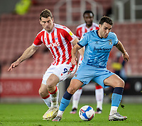21st April 2021; Bet365 Stadium, Stoke, Staffordshire, England; English Football League Championship Football, Stoke City versus Coventry; Matty James of Coventry City under pressure from Sam Vokes of Stoke City