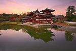 Phoenix Hall, Amida hall of Byodoin Buddhist temple amidst Jodoshiki teien, Pure Land garden pond. Beautiful sunrise scenery. Uji, Kyoto Prefecture, Japan 2017 Image © MaximImages, License at https://www.maximimages.com