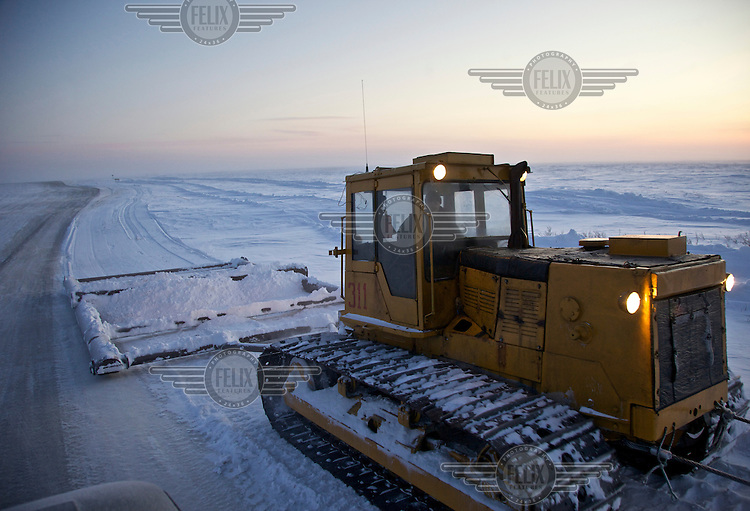 A vehicle constructs an ice-road in the Russian Arctic to serve gas and oil companies exploring in the Nenets Autonomous Region in the Russian Arctic. In the summer the road will melt away revealing the marshland that lies beneath. /Felix Features
