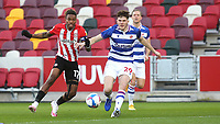 Ivan Toney of Brentford and Reading's Tom Holmes challenge for the ball during Brentford vs Reading, Sky Bet EFL Championship Football at the Brentford Community Stadium on 19th December 2020
