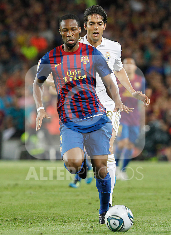 FC Barcelona's Eric Abidal (f) and Real Madrid's Kaka during Spanish Supercup 2nd match.August 17,2011. (ALTERPHOTOS/Acero)