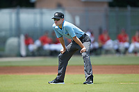 Umpire Matt Baldwin handles the calls on the bases during the South Atlantic League game between the Greensboro Grasshoppers and the Kannapolis Intimidators at Kannapolis Intimidators Stadium on August 5, 2018 in Kannapolis, North Carolina. The Grasshoppers defeated the Intimidators 2-1 in game one of a double-header.  (Brian Westerholt/Four Seam Images)