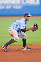 Shortstop Christian Colon #12 of the Wilmington Blue Rocks on defense against the Winston-Salem Dash at  BB&T Ballpark August 4, 2010, in Winston-Salem, North Carolina.  Photo by Brian Westerholt / Four Seam Images