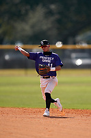 Second baseman Jodany L Ofarril Ortiz (11) throws to first base during the Perfect Game National Underclass East Showcase on January 23, 2021 at Baseball City in St. Petersburg, Florida.  (Mike Janes/Four Seam Images)