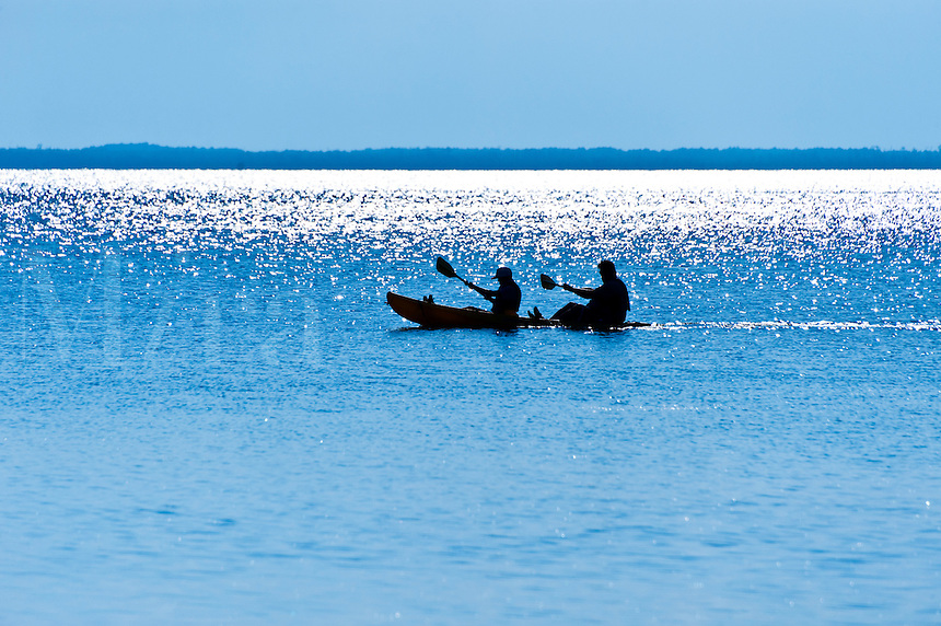 Silhouette of tandem kayakers, Outer Banks, North Carolina
