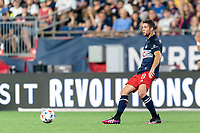 FOXBOROUGH, MA - JULY 7: Matt Polster #8 of New England Revolution passes the ball during a game between Toronto FC and New England Revolution at Gillette Stadium on July 7, 2021 in Foxborough, Massachusetts.