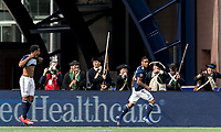 Foxborough, Massachusetts - March 30, 2019: In a Major League Soccer (MLS) match, New England Revolution (blue/white) defeated Minnesota United FC (white), 2-1, at Gillette Stadium.<br /> Goal celebration.