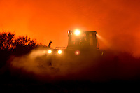 A bulldozer works at the site of a wildfire in Cualedro, on August 25, 2013 (c) Pedro ARMESTRE.