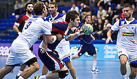02 NOV 2011 - LONDON, GBR - Britain's Gawain Vincent (centre, in  blue and red) has his run through the Israeli defence stopped by Gal Moshe Avraham (left in white) during the Men's 2013 World Handball Championship qualification match at the National Sports Centre at Crystal Palace  (PHOTO (C) NIGEL FARROW)