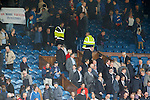 Rangers directors leave at full-time as protesters appear with a banner above the directors box