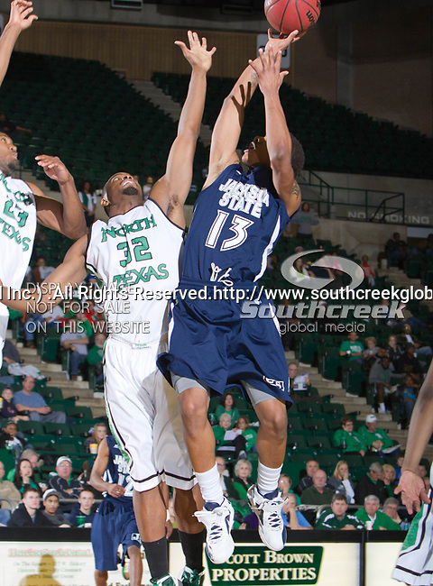 Jackson State Tigers guard Christian Williams (13) and North Texas Mean Green forward Roger Franklin (32) in action during the game between the Jackson State Tigers and the University of North Texas Mean Green at the North Texas Coliseum,the Super Pit, in Denton, Texas. UNT defeated Jackson State 69 to 55...