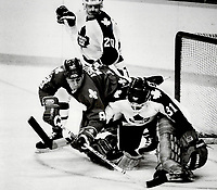 1986 FILE PHOTO - ARCHIVES -<br /> <br /> Goalmouth scramble: Quebec Nordiques left winger Brent Ashton attempts to poke the puck free in front of Leafs'goalie Ken Wregget during game last night at the Gardens. Ashton capitalized on a Leaf miscue for the game's opening goal. Nordiques handed Leafs their first loss of the season; 7-1<br /> <br /> PHOTO :  Keith  BEATY  - Toronto Star Archives - AQP