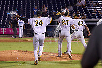 Bradenton Marauders pitcher Oliver Mateo (43) is doused with water by Daniel Rivero (23) and Wandi Montout (24) after closing out Game Three of the Low-A Southeast Championship Series against the Tampa Tarpons on September 24, 2021 at George M. Steinbrenner Field in Tampa, Florida.  (Mike Janes/Four Seam Images)