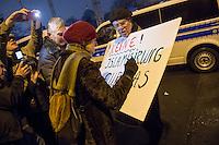 """Etwa 200 Anhaenger des Berliner Ablegers rechten Pegida-Bewegung, Baergida, versammelten sich am Montag den 5. Januar 2015 in Berlin zu einer Demonstration gegen eine angebliche Islamisierung Deutschlands und dagegen, dass """"in 30 Jahren in Deutschland die Sharia herrscht"""", so der Organisator Karl Schmitt.Bis zu 5.000 Menschen protestierten gegen den rechten Ausmarsch und blockierten bei Regen die Marschroute mehrere Stunden. Die Polizei schaffte es nicht mit koerperlicher Gewalt die Blockade zu beenden, so dass die Rechten nach drei Stunden nach Hause gehen mussten. Die Baergida-Anhaenger, """"Berlin gegen die Islamisierung des Abendlandes"""", feierten dies aber dennoch als Sieg. Waren zur ersten Baergida-Aktion eine Woche zuvor nur 5 Menschen gekommen.<br /> Unter den Anhaengern von Baergida waren viele bekannte militante Neonazis und Hooligans sowie Mitglieder der Rechtsparteien AfD und Pro Deutschland und der rechtsradikalen German Defense League. Immer wieder wurde skandiert """"Luegenpresse, auf die Fresse"""" und dass die Journalisten nach Israel verschwinden sollen.<br /> Im Bild: Baergida-Anhaenger verbessern die Aufschrift """"!Keine! Islamisirung €uropas"""" auf dem Schild eines Rechten.<br /> 5.1.2015, Berlin<br /> Copyright: Christian-Ditsch.de<br /> [Inhaltsveraendernde Manipulation des Fotos nur nach ausdruecklicher Genehmigung des Fotografen. Vereinbarungen ueber Abtretung von Persoenlichkeitsrechten/Model Release der abgebildeten Person/Personen liegen nicht vor. NO MODEL RELEASE! Nur fuer Redaktionelle Zwecke. Don't publish without copyright Christian-Ditsch.de, Veroeffentlichung nur mit Fotografennennung, sowie gegen Honorar, MwSt. und Beleg. Konto: I N G - D i B a, IBAN DE58500105175400192269, BIC INGDDEFFXXX, Kontakt: post@christian-ditsch.de<br /> Bei der Bearbeitung der Dateiinformationen darf die Urheberkennzeichnung in den EXIF- und  IPTC-Daten nicht entfernt werden, diese sind in digitalen Medien nach §95c UrhG rechtlich geschuetzt. Der Urhebervermerk wird g"""