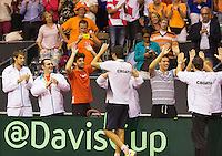 September 14, 2014, Netherlands, Amsterdam, Ziggo Dome, Davis Cup Netherlands-Croatia, Marin Cilic (CRO) wins the dividing rubber 3-2 Croatia and celebrates with his team<br /> Photo: Tennisimages/Henk Koster