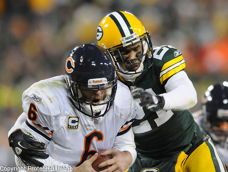 Green Bay Packers cornerback Charles Woodson sacks Chicago Bears quarterback Jay Cutler during the fourth quarter of the game at Lambeau Field in Green Bay, Wis.,  on Jan. 2, 2011.