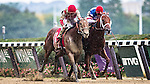 ELMONT, NY - OCTOBER 08: Practical Joke #1, ridden by Joel Rosario, and Syndergaard #3, ridden by John Velazquez, in a photo finish, where Practical Joke won by a nose the 145th Running of The Champagne, on Jockey Club Gold Cup Day at Belmont Park on October 8, 2016 in Elmont, New York. (Photo by Douglas DeFelice/Eclipse Sportswire/Getty Images)
