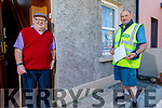 Tralee postman Michael O'Callaghan having a chat with his dad Michael Sr in Kevin Barry's Villas on Friday.