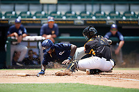 Bradenton Marauders catcher Jason Delay (5) tags Lucius Fox (2) out on a play at the plate during a game against the Charlotte Stone Crabs on June 3, 2018 at LECOM Park in Bradenton, Florida.  Charlotte defeated Bradenton 10-1.  (Mike Janes/Four Seam Images)