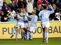 Jubilant Chicago Red Stars midfielder Megan Rapinoe (8, 2nd from left) is congratulated by teammates Karen Carney (14), Brittany Klein (6) and Frida Ostberg (18).  The Chicago Red Stars defeated the Boston Breakers 4-0 at Toyota Park in Bridgeview, IL on April 25, 2009.