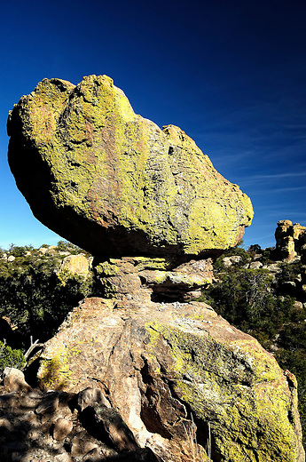 Balanced boulder covered in green lichen, along the Echo Canyon Trail in Chiricahua National Monument, AZ