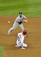 11 October 2012: St. Louis Cardinals second baseman Daniel Descalso turns a double-play to end the 7th inning of Postseason Playoff Game 4 of the National League Divisional Series against the Washington Nationals at Nationals Park in Washington, DC. The Nationals defeated the Cardinals 2-1 tying the Series at 2 games apiece. Mandatory Credit: Ed Wolfstein Photo