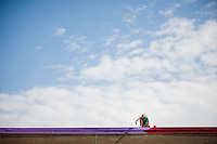 """Samantha Zent paints on the roof during """"Circle the City with Service,"""" the Kiwanis Circle K International's 2015 Large Scale Service Project, on Wednesday, June 24, 2015, at the Friendship Westside Center for Excellence in Indianapolis. (Photo by James Brosher)"""