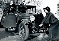 BNPS.co.uk (01202) 558833<br /> Pic: Bonhams/BNPS<br /> <br /> Peter Sellers larks around with the car<br /> <br /> A vintage Austin motorcar comedian Spike Milligan gifted to his Goon Show colleague Peter Sellers after he lost his driving licence has emerged for sale.<br /> <br /> The 1930 Austin Heavy Twelve Open Tourer Deluxe was bought by Milligan in the 1950s after the success of the famous radio show that starred himself, Sellers and Harry Seacombe. <br /> <br /> He nicknamed the touring car 'Old Min' after one of the show's characters.<br /> <br /> The car is coming up for sale with Bonhams for £35,000.