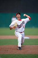 Auburn Doubledays relief pitcher Jonny Reid (12) delivers a pitch during the second game of a doubleheader against the Mahoning Valley Scrappers on July 2, 2017 at Falcon Park in Auburn, New York.  Mahoning Valley defeated Auburn 3-2.  (Mike Janes/Four Seam Images)