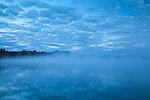 A foggy sunrise on Silver Lake in Madison, NH, USA
