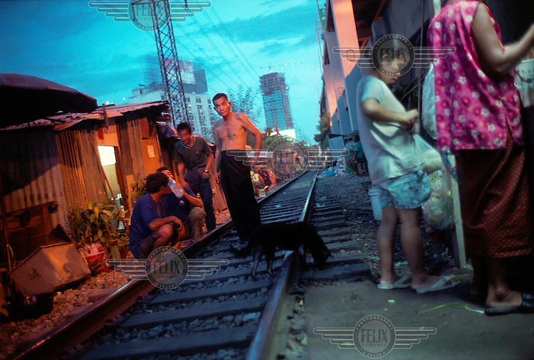 Slum communities around the railway tracks and the Expressway in Bangkok. The majority of people living here are economic migrants who have left the countryside in search of higher paid work.