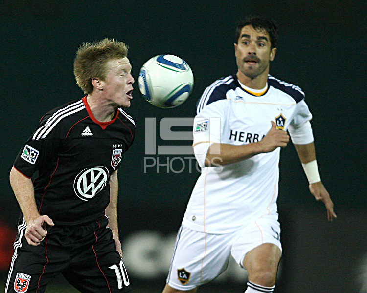 Dax McCarty (10) of D.C. United heads the ball past Juan Pablo Angel (9) of the Los Angeles Galaxy during an MLS match at RFK Stadium, on April 9 2011, in Washington D.C.The game ended in a 1-1 tie.