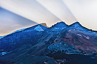 During the sunset at Athabasca Glacier, the sun rays hit the smoke from the BC forest fires between the mountain peaks.